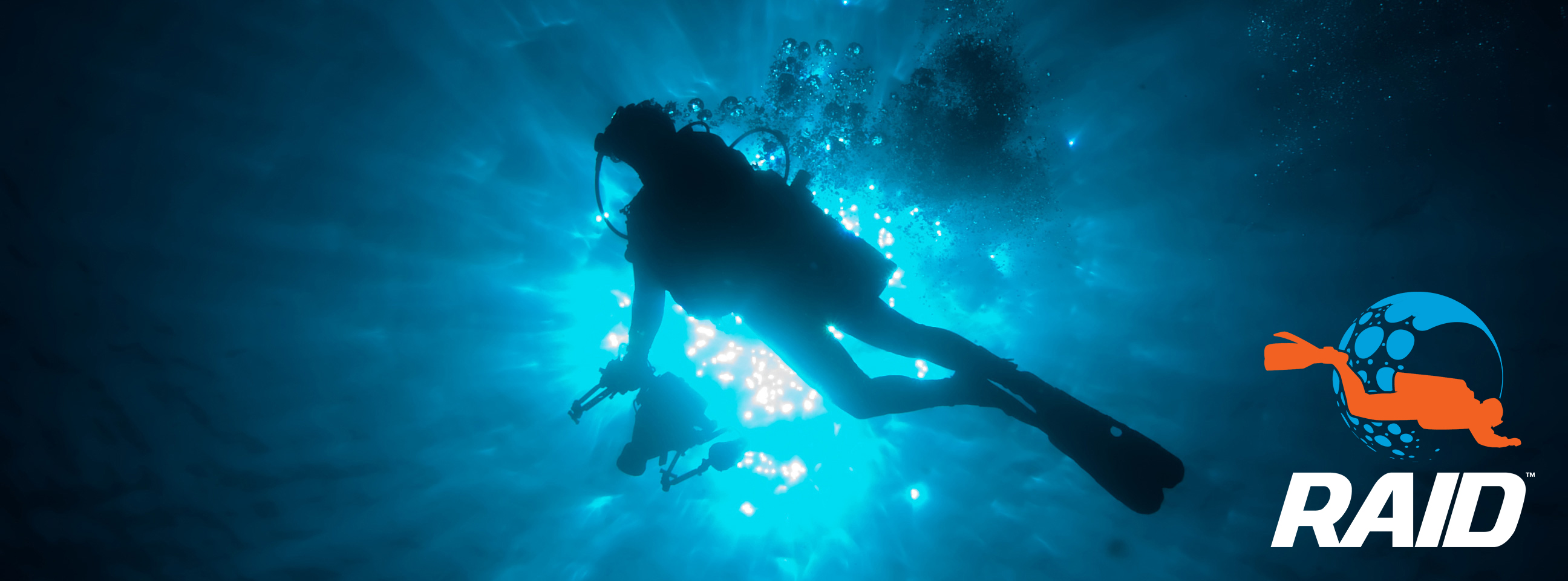 Silhouette Of Diver With Free Diver Above Playing With The Bubbl